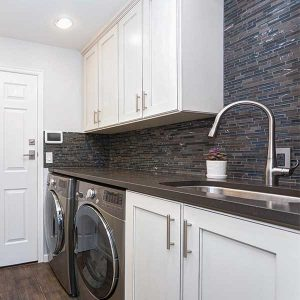Tile Backsplash In Updated Laundry Room